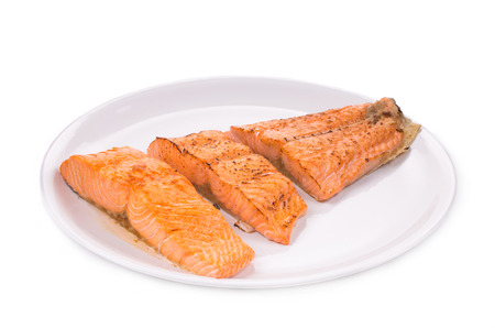 Fried salmon fillet. Isolated on a white background.