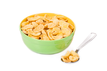 sugarcoated: Bowl of sugar-coated corn flakes with milk and spoon.