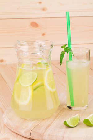 Summer lemonade on wooden close up photo