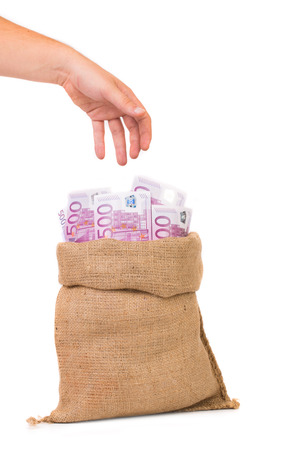 s trap: Man hand with money bag full with euro bills Stock Photo