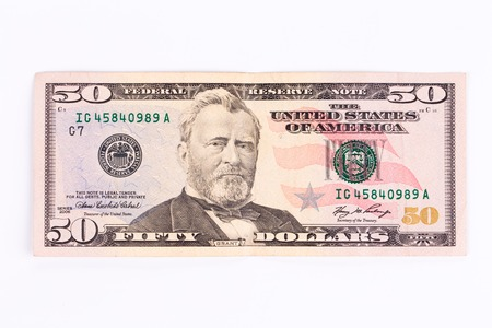 Close up of 50 dollar bill. Isolated on a white background.