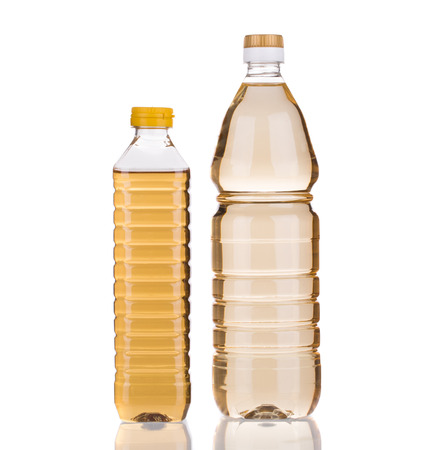 acetic: bottles of vinegar. Isolated on a white background.