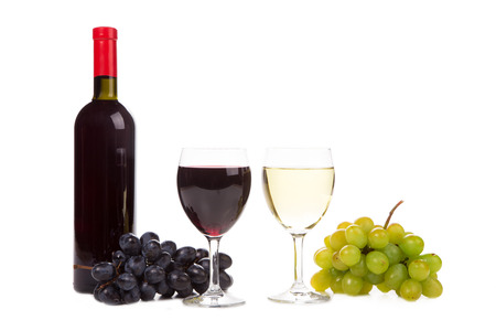 bottle of red wine, two glasses and grapes isolated on white background photo