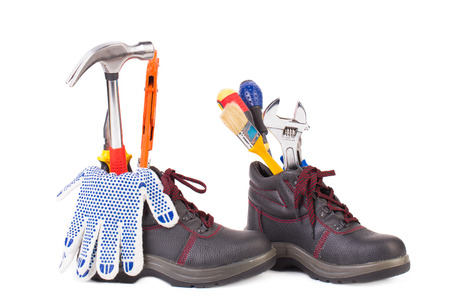 alligator wrench: Working tools in boots. Isolated on a white background. Stock Photo