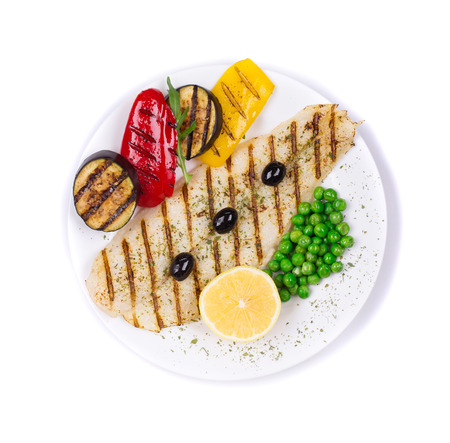 pangasius: Fresh grilled fillet of pangasius. Isolated on a white background.