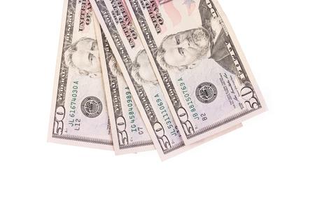 factura: Cierre de diferentes billetes de d�lar. Aislado en un fondo blanco.