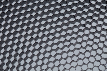 Honeycomb grid against grey background close up photo