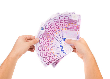 2 50: Hand holding five hundred-euro notes. On a white background.