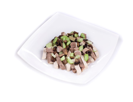 Delicious salad with beef tongue in the closeup isolated photo