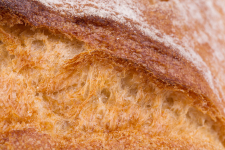 crackling: Crackling white bread. Close up. Whole background.