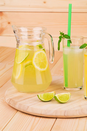 Summer lemonade on wooden background close up photo