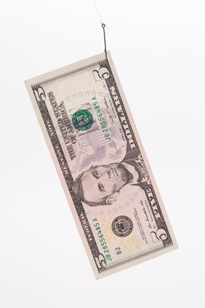 five dollar bill: Five dollar bill on a hook. Isolated on a white background.