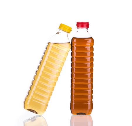 acetic: Bottles full of vinegar. Isolated on a white background.