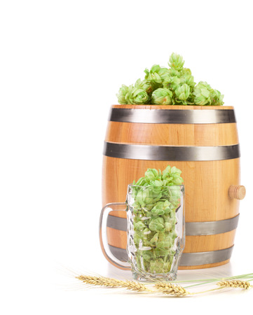 humulus: Mug and barrel with hop. Isolated on a white background. Stock Photo
