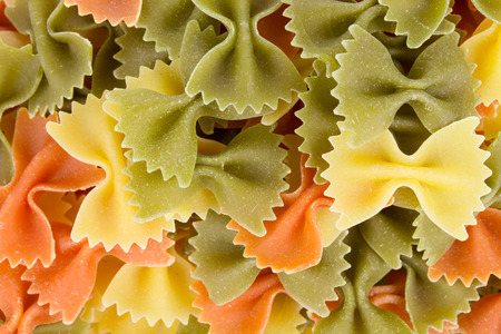 enriched: Heap of farfalle pasta. Isolated on a white background. Stock Photo