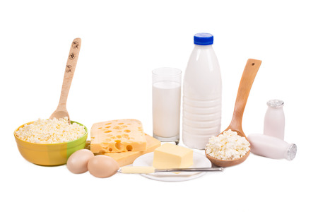dairy products: Dairy products and bread. Isolated on a white background. Stock Photo