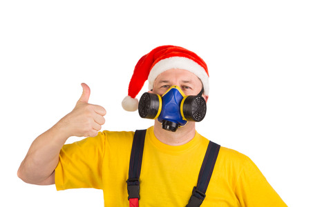 respirator: Worker in xmas hat with respirator. Isolated on a white background.