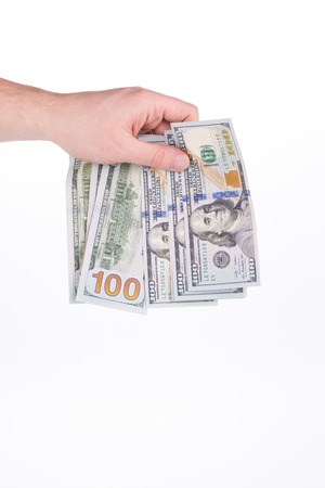 ben franklin money: Hand holding hundred dollar bills. Isolated on a white background. Stock Photo