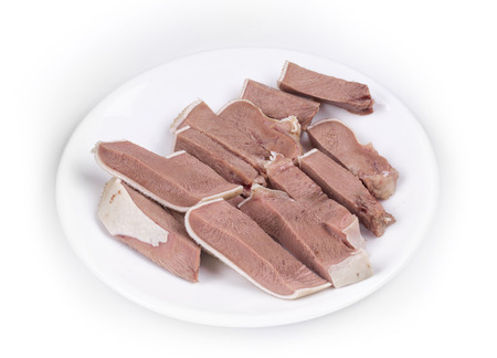 cow tongue: Sliced beef tongue. Isolated on a white background. Stock Photo