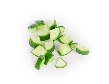 cuke: Fresh sliced cucumber. Isolated on a white background.