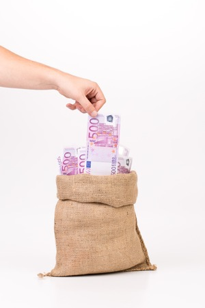 euro bill: Man hand taking money euro bill from bag. Isolated on a white background.