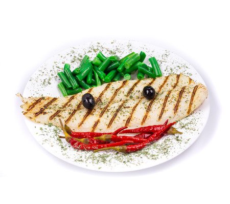 coal fish: Grilled pangasius fillet on plate. Isolated on a white background.