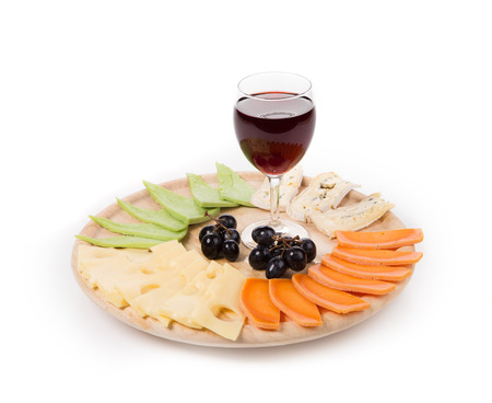 cheese platter: Red wine and cheese composition. Isolated on a white background.