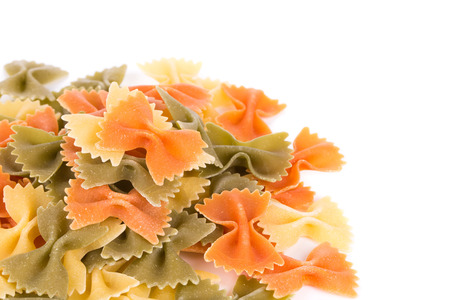 disorganized: A background of the farfalle pasta three colors close-up.
