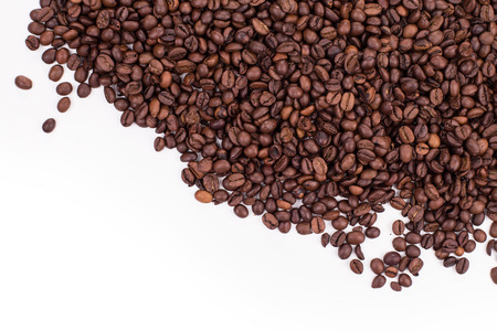 coffee harvest: coffee beans isolated on a white background