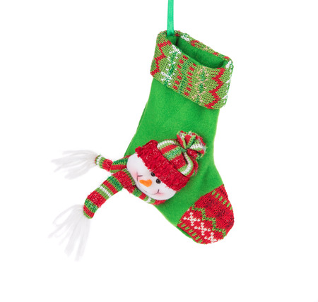 snowman isolated: Christmas green sock with snowman. Isolated on a white background.