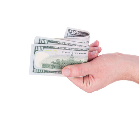 ben franklin money: Hand holding hundred dollar bill. Isolated on a white background. Stock Photo