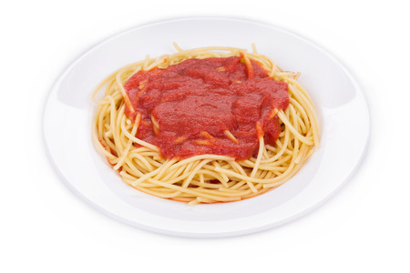 haute cuisine: Pasta with tomato sauce and basil as a haute cuisine. Isolated on a white background. Stock Photo