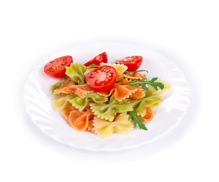 disorganized: Bunch of the farfalle pasta three colors. Whole background. Stock Photo