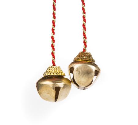 campanas de navidad: Campanas de Navidad en un fondo blanco de cerca Foto de archivo