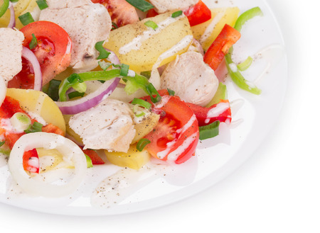 haute cuisine: Warm meat salad with vegetables. Isolated on a white background as haute cuisine.