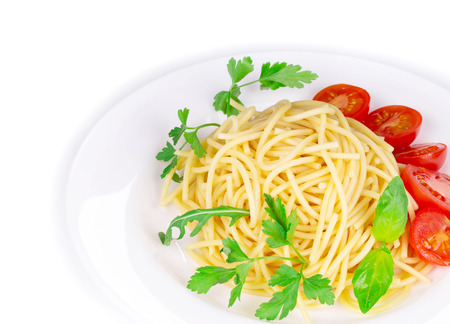 haute cuisine: Tagliatelli pasta with tomatoes and basil. Isolated on a white background as a haute cuisine. Stock Photo