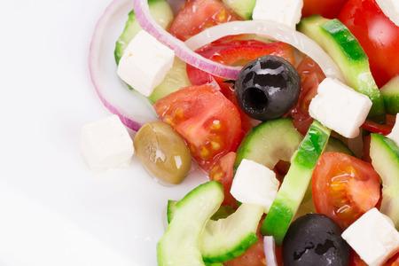 haute cuisine: Greek salad as haute cuisine. Isolated on a white background.