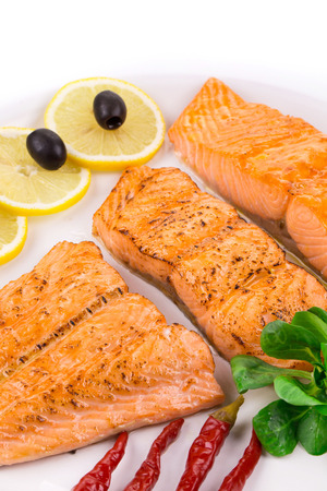 haute cuisine: Grilled salmon on white plate close up as a haute cuisine
