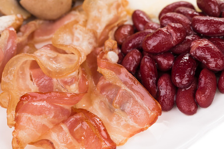 haute cuisine: English breakfast with fried bacon beansand fresh salad. Haute cuisine.