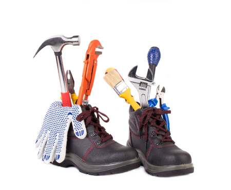 decibels: Boots with tools inside. Isolated on a white background.