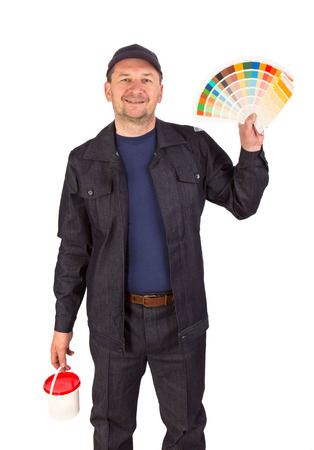 Worker with color samples. Isolated on a white background. photo