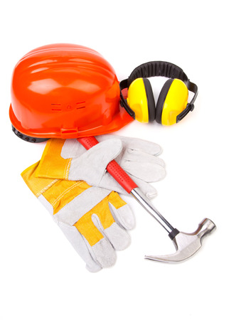 casco rojo: Red helmet and working tools. Isolated on a white background.