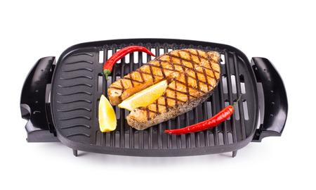 haute cuisine: Fried salmon steak on grill as haute cuisine. Whole background.