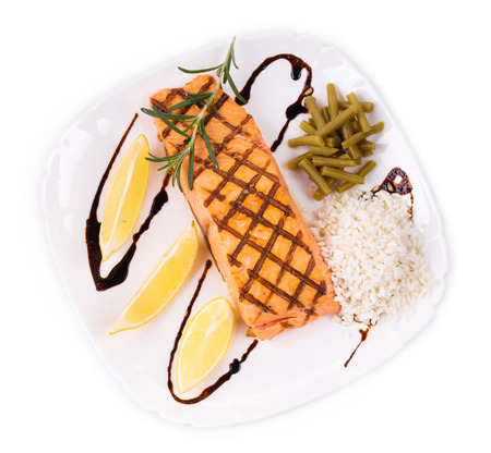 haute cuisine: Salmon Fillet with Risotto as haute cuisine. Isolated on a white background.