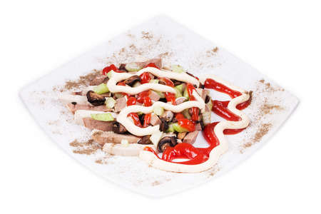 haute cuisine: Delicious salad with beef tongue as haute cuisine in the closeup isolated