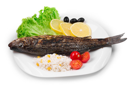 pikeperch: Grilled fish with vegetables. On a white plate.