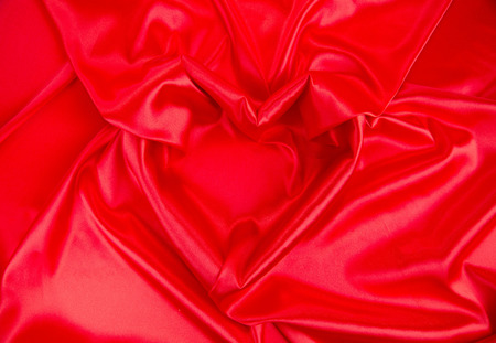 draped: Red satin draped in the form of heart