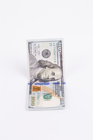 ben franklin money: American dollar bill. Isolated on a white background.
