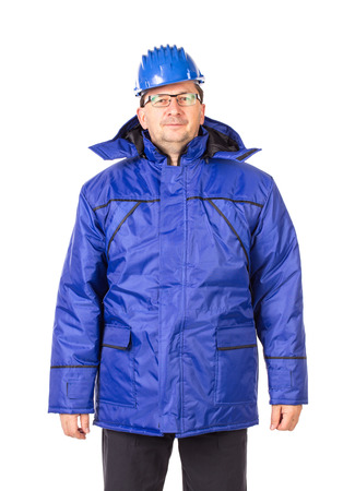 outwear: Worker in blue workwear. Isolated on a white background. Stock Photo