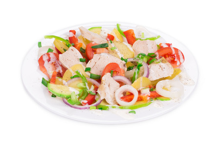 haute cuisine: Meat salad with vegetables as haute cuisine. Close up on a Whole background.